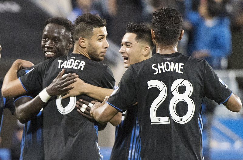 Montreal Impact's Saphir Taider (8) celebrates with teammates after scoring on a penalty kick against Real Salt Lake during the second half of an MLS soccer match Wednesday, May 29, 2019, in Montreal. (Graham Hughes/The Canadian Press via AP)