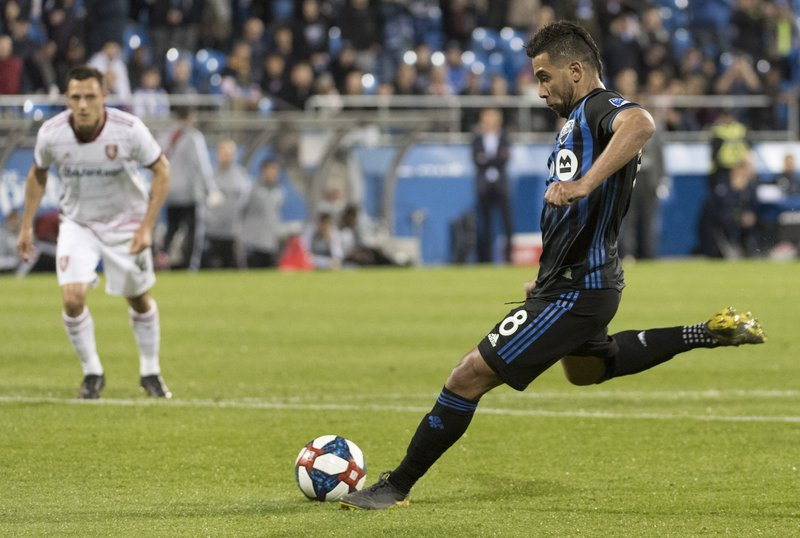Montreal Impact's Saphir Taider scores on a penalty kick against Real Salt Lake during the second half of an MLS soccer match Wednesday, May 29, 2019, in Montreal. (Graham Hughes/The Canadian Press via AP)