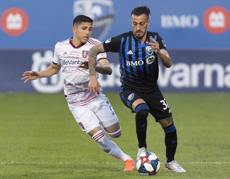 Montreal Impact's Maximiliano Urruti, right, challenges Real Salt Lake's Jefferson Savarino during the first half of an MLS soccer match Wednesday, May 29, 2019, in Montreal. (Graham Hughes/The Canadian Press via AP)