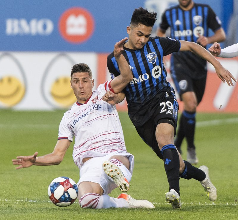 Montreal Impact's Mathieu Choiniere, right, challenges Real Salt Lake's Damir Kreilach during the first half of an MLS soccer match Wednesday, May 29, 2019, in Montreal. (Graham Hughes/The Canadian Press via AP)