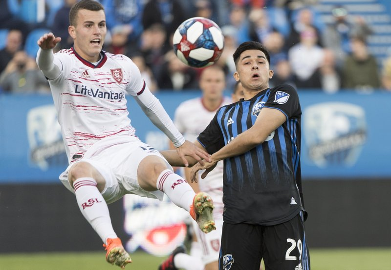 Montreal Impact's Mathieu Choiniere, right, challenges Real Salt Lake's Brooks Lennon during the first half of an MLS soccer match Wednesday, May 29, 2019, in Montreal. (Graham Hughes/The Canadian Press via AP)
