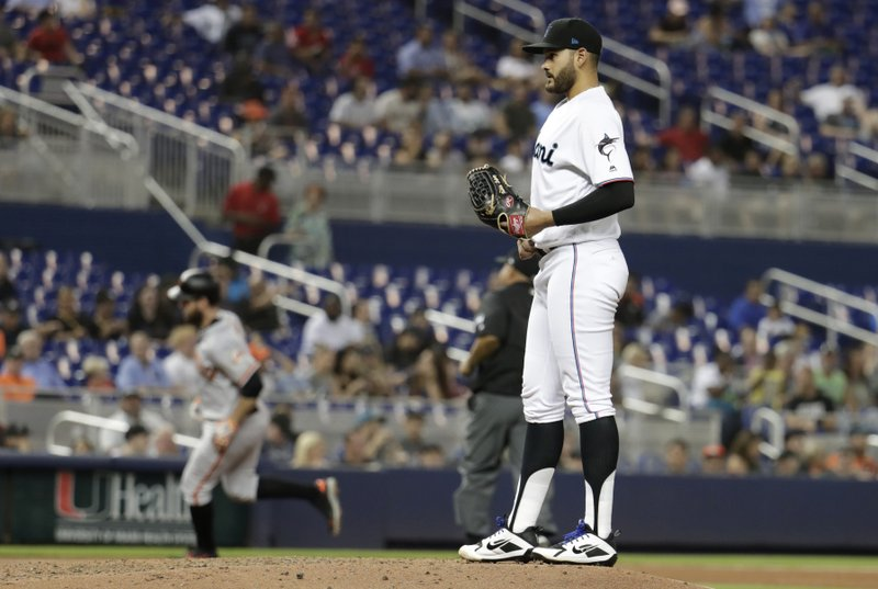 Miami Marlins starting pitcher Pablo Lopez stands on the mound as San Francisco Giants' Brandon Belt rounds the bases on a solo home run during the fourth inning of a baseball game Wednesday, May 29, 2019, in Miami. (AP Photo/Lynne Sladky)