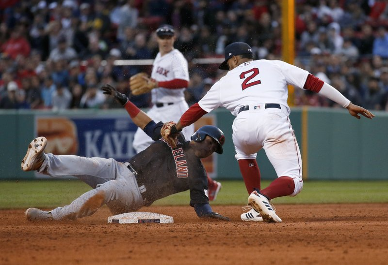 Boston Red Sox shortstop Xander Bogaerts (2) tags out Cleveland Indians' Leonys Martin at second during the third inning of a baseball game Wednesday, May 29, 2019, in Boston. (AP Photo/Mary Schwalm)