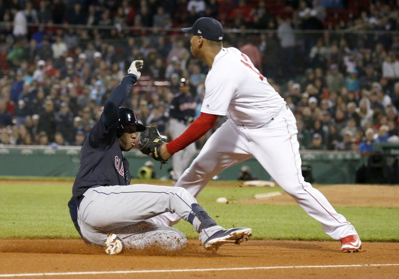 Cleveland Indians' Greg Allen slides into third for a triple ahead of the tag from Boston Red Sox third baseman Rafael Devers (11) during the seventh inning of a baseball game Wednesday, May 29, 2019, in Boston. (AP Photo/Mary Schwalm)