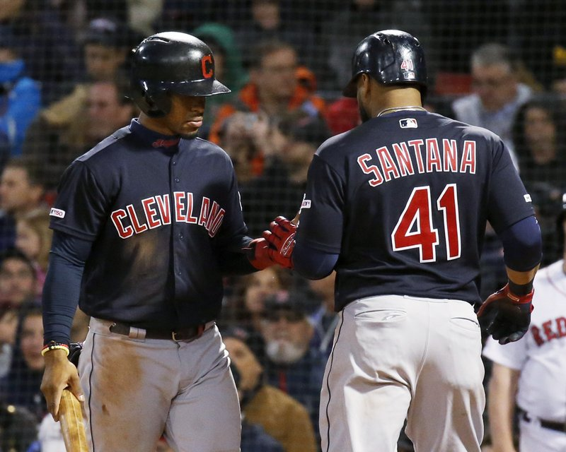 Cleveland Indians' Francisco Lindor congratulates Carlos Santana (41) after they scored on a double by Jose Ramirez during the sixth inning of the team's baseball game against the Boston Red Sox, Wednesday, May 29, 2019, in Boston. (AP Photo/Mary Schwalm)