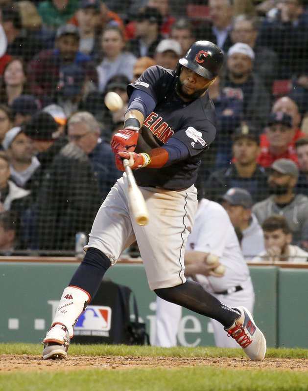 Cleveland Indians' Carlos Santana hits a solo home run during the fourth inning of the team's baseball game against the Boston Red Sox, Wednesday, May 29, 2019, in Boston. (AP Photo/Mary Schwalm)