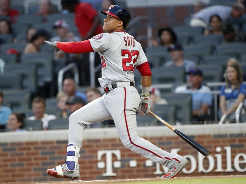 Washington Nationals' Juan Soto (22) follows through on a solo home run in the fourth inning of a baseball game against the Atlanta Braves Wednesday, May 29, 2019, in Atlanta. (AP Photo/John Bazemore)