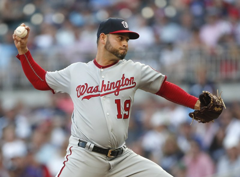 Washington Nationals pitcher Anibal Sanchez works in the first inning of a baseball game against the Atlanta Braves Wednesday, May 29, 2019, in Atlanta. (AP Photo/John Bazemore)