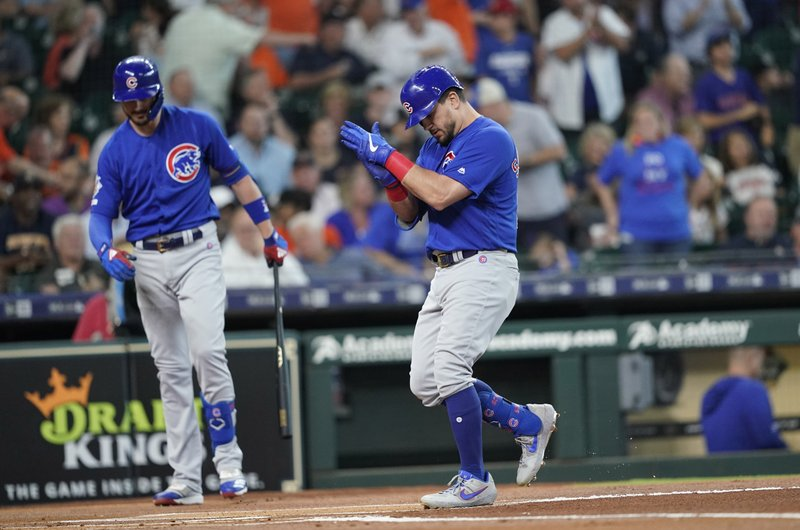 Chicago Cubs' Kyle Schwarber, right, celebrates at home plate after hitting a home run against the Houston Astros during the first inning of a baseball game Wednesday, May 29, 2019, in Houston. (AP Photo/David J. Phillip)