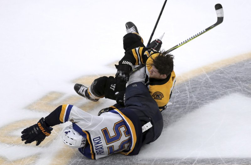 Boston Bruins' Torey Krug, rear, tangles with St. Louis Blues' Colton Parayko during the second period in Game 2 of the NHL hockey Stanley Cup Final, Wednesday, May 29, 2019, in Boston. (AP Photo/Charles Krupa)