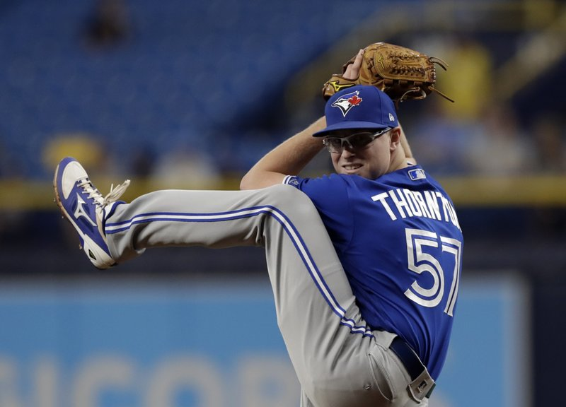 Toronto Blue Jays starting pitcher Trent Thornton goes into his wind up on a pitch to the Tampa Bay Rays during the first inning of a baseball game Wednesday, May 29, 2019, in St. Petersburg, Fla. (AP Photo/Chris O'Meara)