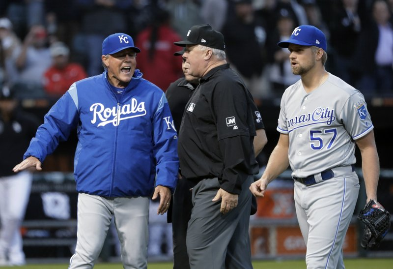Kansas City Royals manager Ned Yost, left, appeals to umpire crew chief Bill Miller, center, after home plate umpire Mark Carlson ejected starting pitcher Glenn Sparkman (57) for hitting Chicago White Sox's Tim Anderson with a pitch during the second inning of a baseball game Wednesday, May 29, 2019, in Chicago. (AP Photo/Charles Rex Arbogast)
