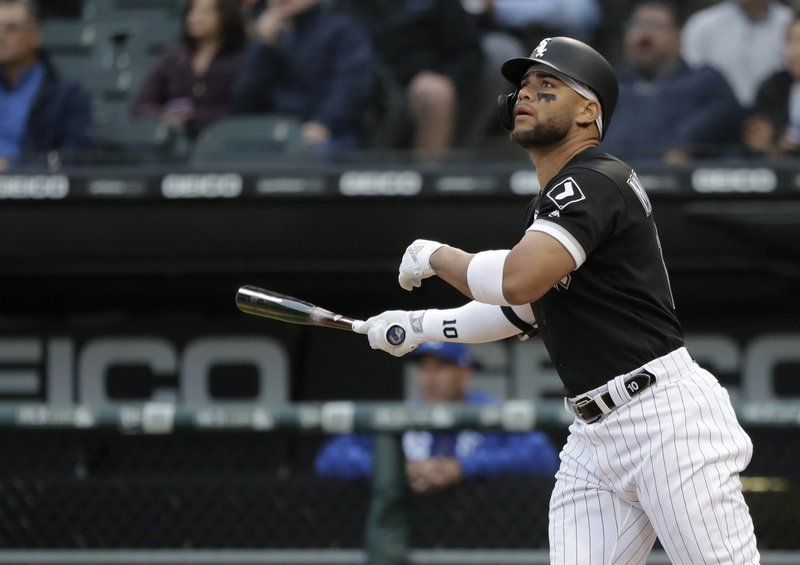 Chicago White Sox's Yoan Moncada watches his two-run home run off Kansas City Royals starting pitcher Glenn Sparkman during the first inning of a baseball game Wednesday, May 29, 2019, in Chicago. (AP Photo/Charles Rex Arbogast)