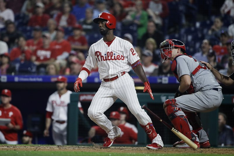 Philadelphia Phillies' Andrew McCutchen follows the flight of the ball after hitting a home run with one run batted in off of St. Louis Cardinals pitcher Michael Wacha during the fifth inning of a baseball game, Wednesday, May 29, 2019, in Philadelphia. (AP Photo/Matt Rourke)