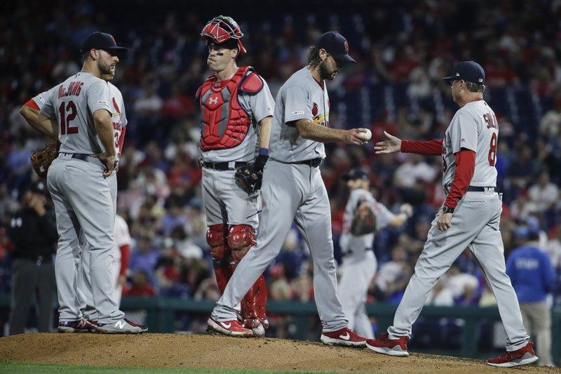 St. Louis Cardinals manager Mike Shildt, right, takes the ball from pitcher Michael Wacha during the fifth inning of a baseball game, Wednesday, May 29, 2019, in Philadelphia. (AP Photo/Matt Rourke)