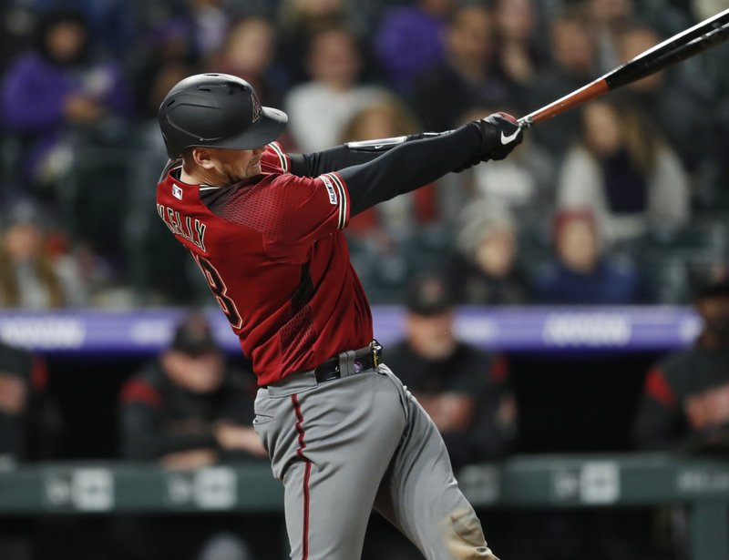 Arizona Diamondbacks' Carson Kelly swings for a solo home run off Colorado Rockies relief pitcher Seunghwan Oh during the sixth inning of a baseball game Wednesday, May 29, 2019, in Denver. (AP Photo/David Zalubowski)