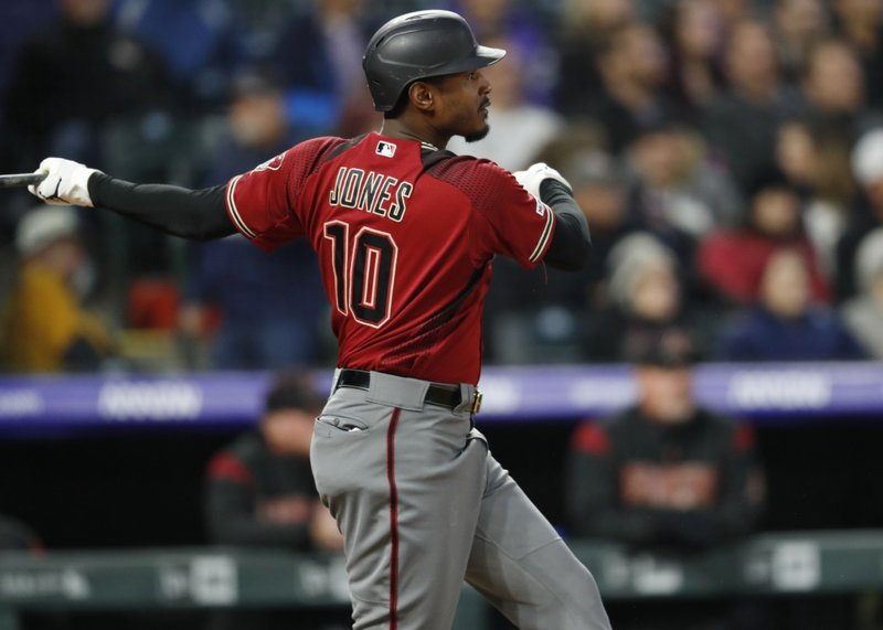 Arizona Diamondbacks' Adam Jones follows the flight of his solo home run off Colorado Rockies starting pitcher Jeff Hoffman in the fifth inning of a baseball game Wednesday, May 29, 2019, in Denver. (AP Photo/David Zalubowski)