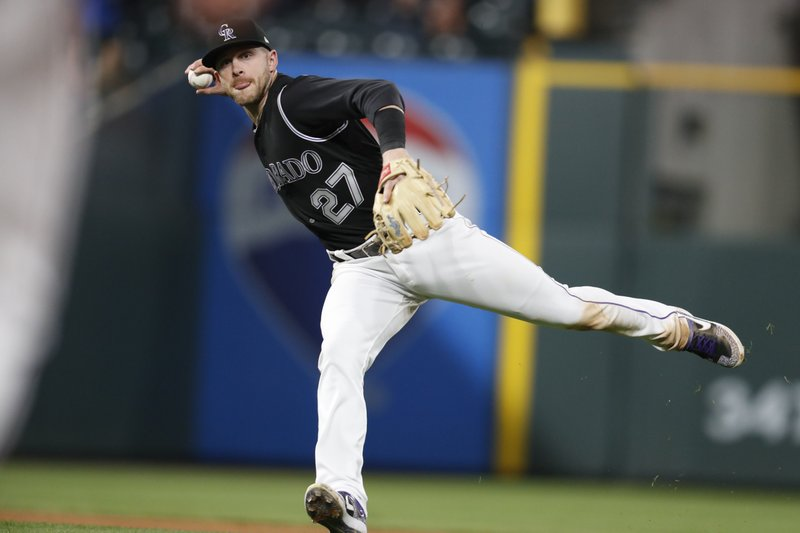 Colorado Rockies shortstop Trevor Story throws to first base to put out Arizona Diamondbacks' Nick Ahmed during the sixth inning of a baseball game Wednesday, May 29, 2019, in Denver. (AP Photo/David Zalubowski)