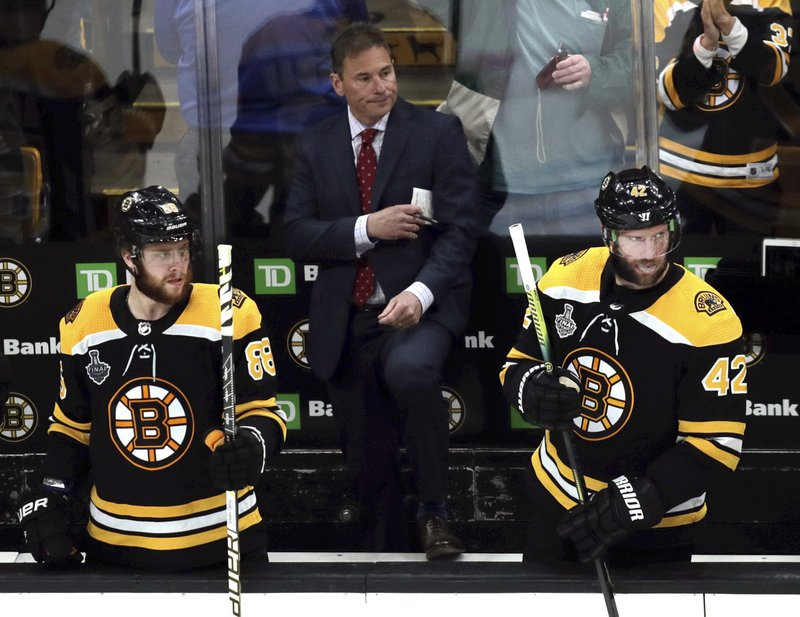Boston Bruins head coach Bruce Cassidy watches from behind the bench during the second period in Game 2 of the NHL hockey Stanley Cup Final against the St. Louis Blues, Wednesday, May 29, 2019, in Boston. (AP Photo/Charles Krupa)