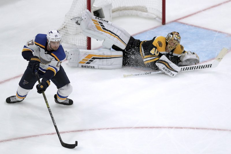 St. Louis Blues' Jaden Schwartz, left, carries the puck as Boston Bruins goaltender Tuukka Rask, of Finland, defends the net during the third period in Game 2 of the NHL hockey Stanley Cup Final, Wednesday, May 29, 2019, in Boston. (AP Photo/Charles Krupa)