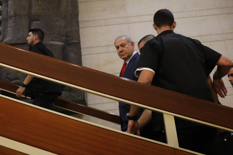Israeli Prime Minister Benjamin Netanyahu leaves after voting in the Knesset, Israel's parliament in Jerusalem, Thursday, May 30, 2019. Israel's parliament has voted to dissolve itself, sending the country to an unprecedented second snap election this year as Prime Minister Benjamin Netanyahu failed to form a governing coalition before a midnight deadline. (AP Photo/Sebastian Scheiner)