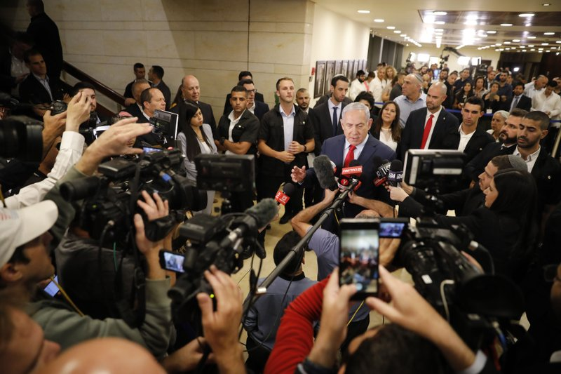 Israeli Prime Minister Benjamin Netanyahu speaks to the media after voting in the Knesset, Israel's parliament in Jerusalem, Thursday, May 30, 2019. Israel's parliament has voted to dissolve itself, sending the country to an unprecedented second snap election this year as Prime Minister Benjamin Netanyahu failed to form a governing coalition before a midnight deadline. (AP Photo/Sebastian Scheiner)