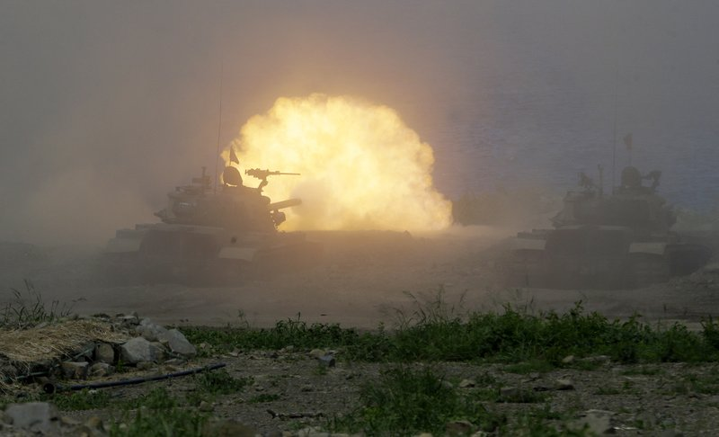 An M109 self-propelled Howitzer fire during the annual Han Kuang exercises in Pingtung County, Sorthern Taiwan, Thursday, May 30, 2019. (AP Photo/Chiang Ying-ying)