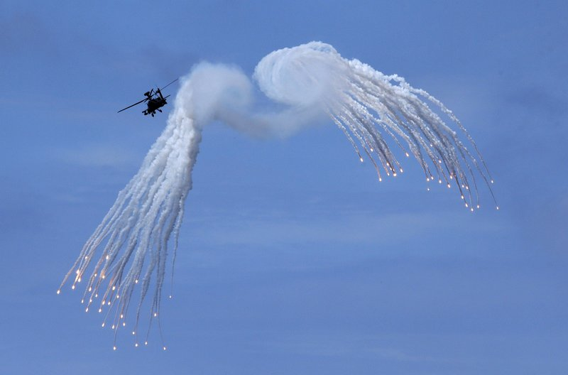 Taiwan's AH-64E Apache attack helicopter launches flares during the annual Han Kuang exercises in Pingtung County, Southern Taiwan, Thursday, May 30, 2019. (AP Photo/Chiang Ying-ying)