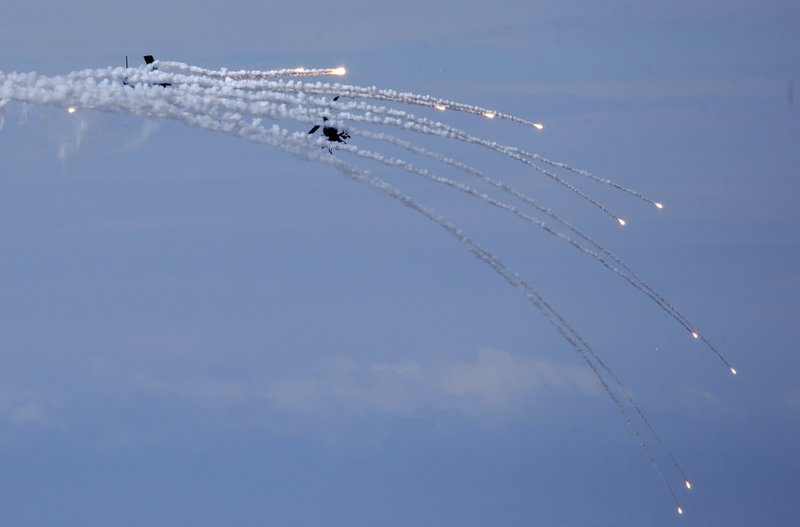 An AH-1W Attack Helicopter launches flares during the annual Han Kuang exercises in Pingtung County, Southern Taiwan, Thursday, May 30, 2019. (AP Photo/Chiang Ying-ying)