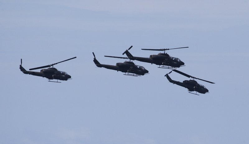 Taiwan's AH-64E Apache attack helicopters fly in formation during the annual Han Kuang exercises in Pingtung County, Southern Taiwan, Thursday, May 30, 2019. (AP Photo/Chiang Ying-ying)