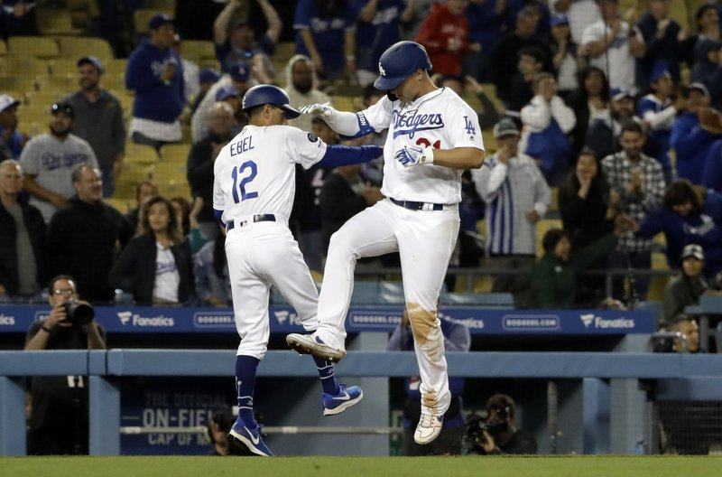Los Angeles Dodgers' Joc Pederson, right, celebrates with third base coach Dino Ebel (12) after hitting a solo home run during the ninth inning of a baseball game against the New York Mets Wednesday, May 29, 2019, in Los Angeles. (AP Photo/Marcio Jose Sanchez)
