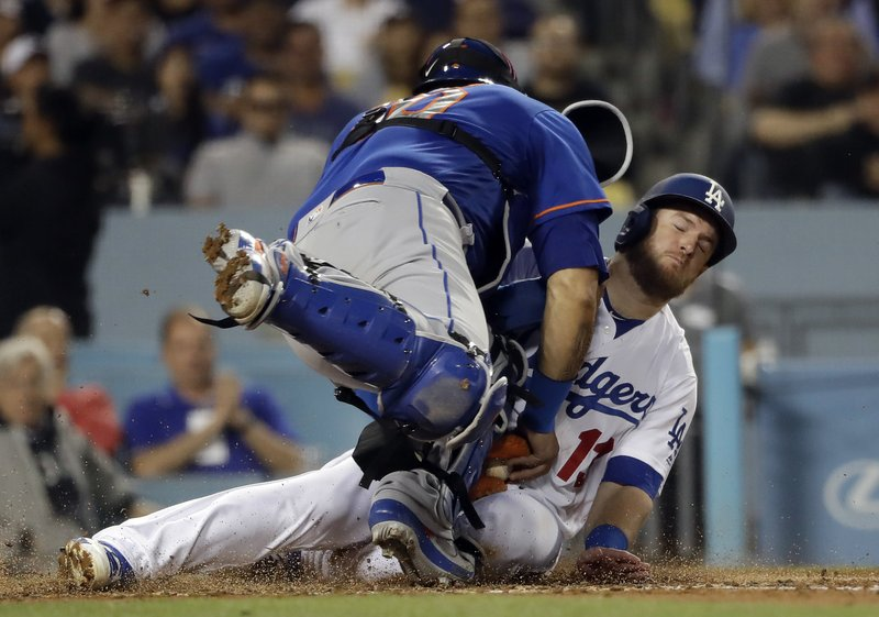 Los Angeles Dodgers' Max Muncy rear, scores against New York Mets catcher Wilson Ramos on a single from Justin Turner during the third inning of a baseball game Wednesday, May 29, 2019, in Los Angeles. (AP Photo/Marcio Jose Sanchez)