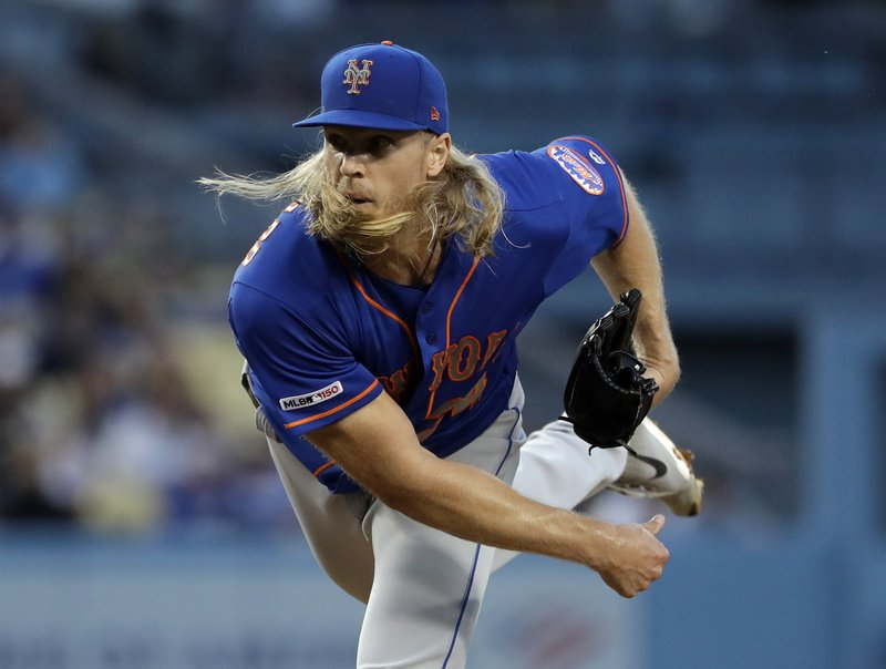 New York Mets starting pitcher Noah Syndergaard watches a throw to a Los Angeles Dodgers batter during the second inning of a baseball game Wednesday, May 29, 2019, in Los Angeles. (AP Photo/Marcio Jose Sanchez)