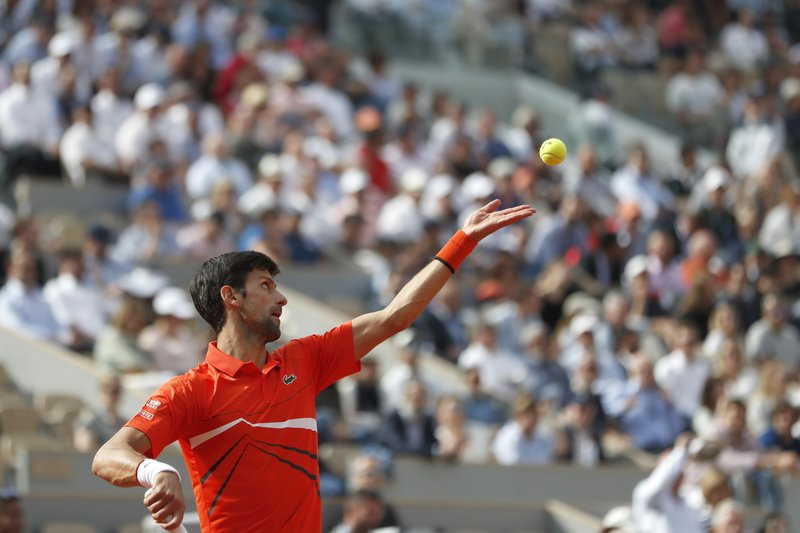 Serbia's Novak Djokovic serves against Poland's Hubert Hurkacz during their first round match of the French Open tennis tournament at the Roland Garros stadium in Paris, Monday, May 27, 2019. (AP Photo/Pavel Golovkin)