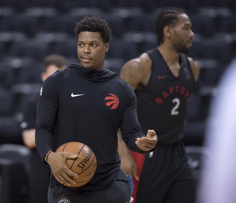 Toronto Raptors' Kyle Lowry, left, and teammate Kawhi Leonard practice for the NBA Finals in Toronto on Wednesday, May 29, 2019. Game 1 of the NBA Finals between the Raptors and Golden State Warriors is Thursday in Toronto. (Frank Gunn/The Canadian Press via AP)