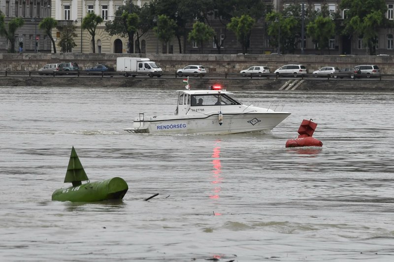 A fire brigade rescue boat takes part in the search operations for survivors on the River Danube in downtown Budapest, Hungary, Thursday, May 30, 2019, following a collision of a hotel ship and a smaller sightseeing boat on the previous evening. A massive search was underway on the river for 21 people missing after the sightseeing boat with 33 South Korean tourists sank after colliding with another vessel during an evening downpour. (Zoltan Mathe/MTI via AP)