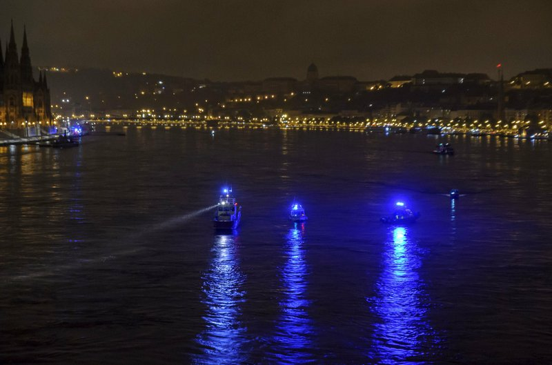 Ships conduct a search operation for survivors on the River Danube in downtown Budapest, Hungary, Thursday, May 30, 2019, as a sightseeing boat collided with another vessel and capsized Wednesday night. The cruise ship sank with thirty-three South Korean passengers and two Hungarian staff on board. (Peter Lakatos/MTI via AP)