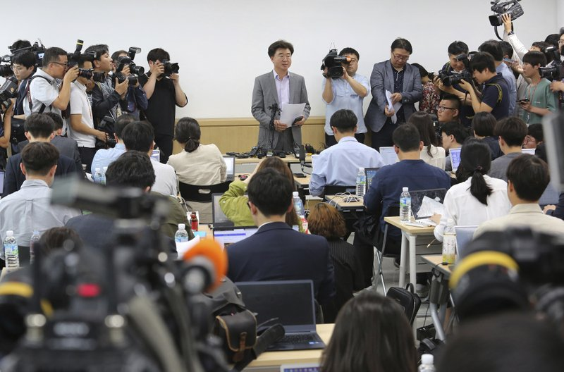 Lee Sang-moo, senior official of The Very Good Tour agency, top center, speaks during a press conference at its headquarters in Seoul, South Korea, Thursday, May 30, 2019. A sightseeing boat carrying 33 South Korean passengers and two crew members collided with another vessel and sank in the Danube River in downtown Budapest. (AP Photo/Ahn Young-joon)