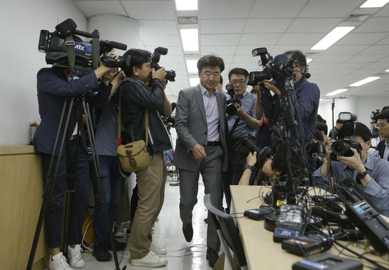 The Very Good Tour agency senior official Lee Sang-moo, center, arrives to hold a press conference at its headquarters in Seoul, South Korea, Thursday, May 30, 2019. A sightseeing boat carrying 33 South Korean passengers and two crew members collided with another vessel and sank in the Danube River in downtown Budapest. (AP Photo/Ahn Young-joon)