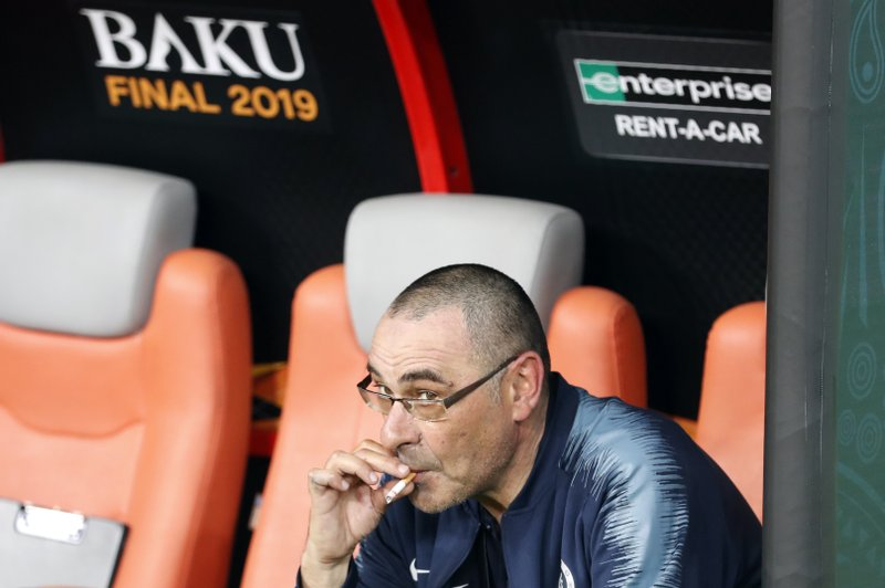 Chelsea head coach Maurizio Sarri smokes a cigarette on the bench after winning the Europa League Final soccer match between Chelsea and Arsenal at the Olympic stadium in Baku, Azerbaijan, Thursday, May 30, 2019. Chelsea won 4-1. (AP Photo/Darko Bandic)