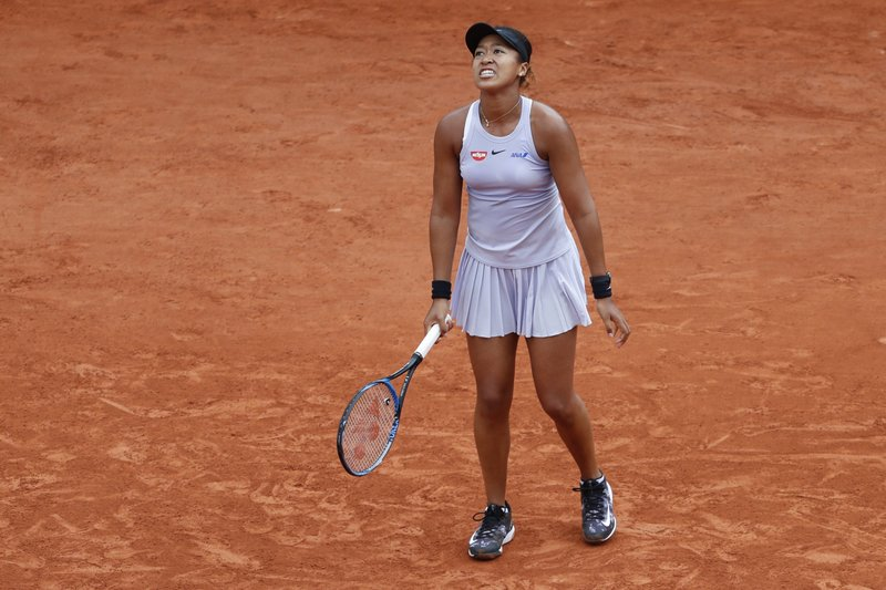Japan's Naomi Osaka reacts after missing a shot during her second round match of the French Open tennis tournament against Victoria Azarenka of Belarus at the Roland Garros stadium in Paris, Thursday, May 30, 2019. (AP Photo/Jean-Francois Badias)