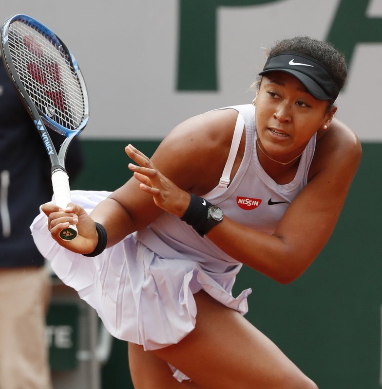 Japan's Naomi Osaka plays a shot against Victoria Azarenka of Belarus during their second round match of the French Open tennis tournament at the Roland Garros stadium in Paris, Thursday, May 30, 2019. (AP Photo/Jean-Francois Badias)