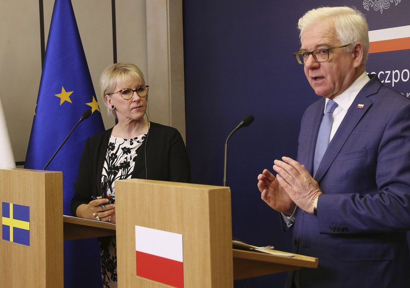 Sweden's Foreign Minister Margot Wallstrom, left, and Poland's Foreign Minister Jacek Czaputowicz address the media during a press conference in Warsaw, Poland, Thursday, May 30, 2019. Wallstrom and Czaputowicz will travel to Ukraine's capital Kiew on Sunday to show Europe's support for Ukraine's reform and territorial integrity. (AP Photo/Czarek Sokolowski)