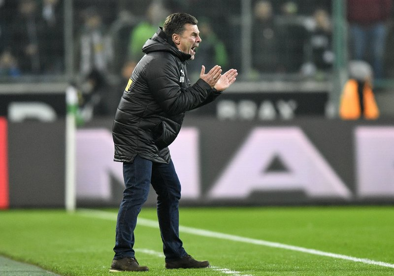 FILE -- In this Sunday, Nov. 25, 2018 photo Moenchengladbach then coach Dieter Hecking reacts during the German Bundesliga soccer match between Borussia Moenchengladbach and Hannover 96 at the Borussia Park in Moenchengladbach, Germany. German second division, 2. Bundesliga, club Hamburger SV has appointed Dieter Hecking as the new coach to lead the club back into the Bundesliga.  (AP Photo/Martin Meissner, file)