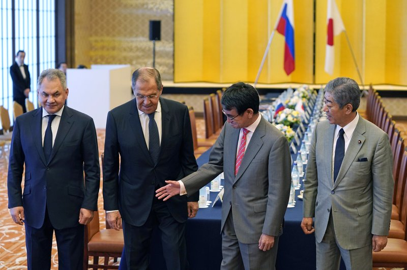 Japanese Foreign Minister Taro Kono, second from right, with Defense Minister Takeshi Iwaya, right, shows the way to Russian Foreign Minister Sergei Lavrov, second from left, and Defense Minister Sergei Shoigu prior to their meeting at the Iikura guest house in Tokyo Thursday, May 30, 2019. They hold meetings amid lack of progress on settling island disputes. (Franck Robichon/Pool Photo via AP)