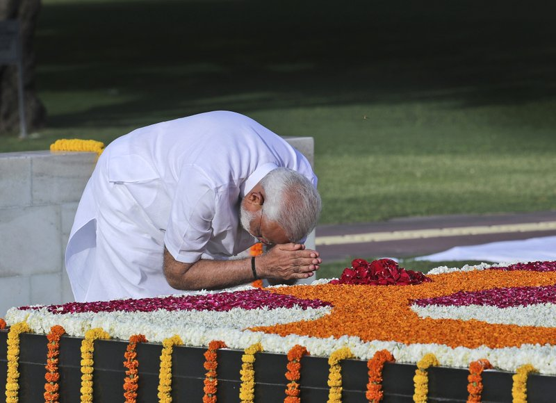 Indian Prime Minister Narendra Modi pays tribute at Rajghat, the memorial to Mahatma Gandhi, before being sworn in for his second term as Indian prime minister this evening in New Delhi, India, Thursday, May 30, 2019. India's president on Saturday appointed Modi as the prime minister soon after newly-elected lawmakers from the ruling alliance, led by the Hindu nationalist Bharatiya Janata Party, elected him as their leader after a thunderous victory in national elections. (AP Photo/Manish Swarup)