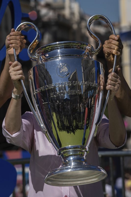 The Champions League trophy is displayed at Puerta del Sol square in downtown Madrid, Spain, Thursday, May 30, 2019. Madrid will be hosting the final again after nearly a decade, but the country's streak of having at least one team playing for the European title ended this year after five straight seasons, giving home fans little to cheer for when Liverpool faces Tottenham at the Wanda Metropolitano Stadium on Saturday. (AP Photo/Bernat Armangue)