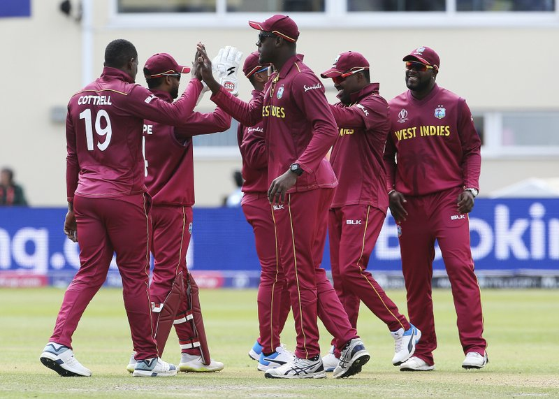 West Indies celebrate taking the wicket of New Zealand's Martin Guptill during the ICC Cricket World Cup Warm up match between New Zealand and the West Indies at the Bristol County Ground, Bristol, England, Tuesday, May 28, 2019. (Mark Kerton/PA via AP)