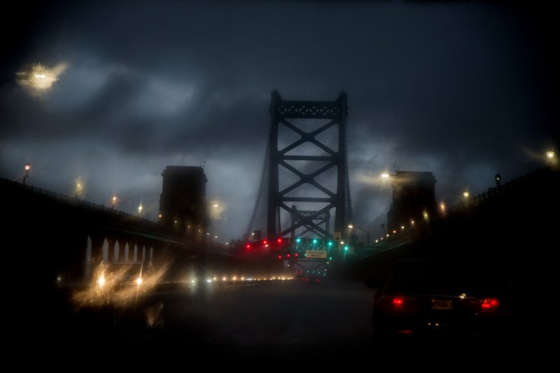 A fast moving storm crosses over the Ben Franklin Bridge from Philadelphia to New Jersey on Wednesday, May 29, 2019.   Pennsylvania faces a third day of severe weather while people clean up from storms that downed trees, power lines and caused flooding.  Thursday's forecast calls for storms that could pack damaging wind and hail.  (Tom Gralish/The Philadelphia Inquirer via AP)