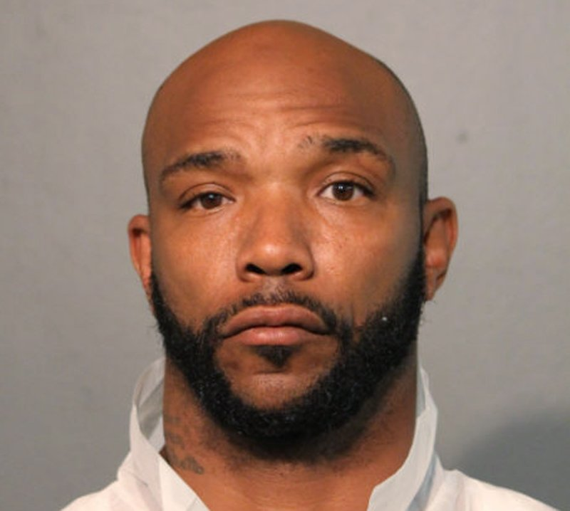 This undated photo provided by the Chicago Police Department shows Michael Washington. Washington and Eric Adams, have been charged with with first-degree murder in the Chicago shooting death of a woman who was shielding her 1-year-old daughter from their gunfire. Authorities say Washington and Adams are due in court Thursday, May 30, 2019. They are both from Urbana, Ill. The men are charged in the Tuesday morning fatal shooting of 24-year-old Brittany Hill. Police believe they were targeting three people near Hill in a gang-related conflict. (Chicago Police Department via AP)